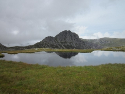 Tryfan reflected in the waters of Llyn Caseg-fraith in the Glyderau, North Wales. Aug 2015.